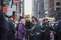 NEW YORK,NY APRIL 14: Police officers  stop some people who tried to cross the street around the Hyatt hotel during  the Anti Trump rally in midtown Manhattan on April 14,2016 in New York City. Photo by VIEWpress/Maite H. Mateo