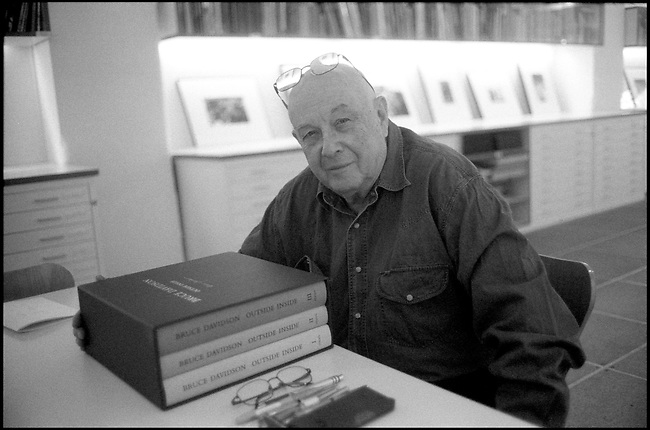 Black and White Photograph of Bruce Davidson, Photographer, at Magnum Print Room, May 3, 2011, London, UK with his Outside Inside Book Set published by Steidl.