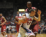 "Ole Miss' Marshall Henderson (22) vs. Arkansas' Marshawn Powell (33) at the C.M. ""Tad"" Smith Coliseum in Oxford, Miss. on Saturday, January 19, 2013. Mississippi won 76-64. (AP Photo/Oxford Eagle, Bruce Newman)"