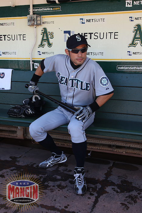 OAKLAND, CA - SEPTEMBER 6:  Ichiro Suzuki #51 of the Seattle Mariners gets ready in the dugout before the game against the Oakland Athletics at the Oakland-Alameda County Coliseum on September 6, 2010 in Oakland, California. Photo by Brad Mangin