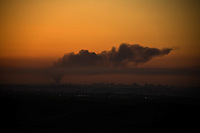 near Sderot, Israel, Jan 06, 2009.A view from the northern Gaza strip at the end of the 11th day of the israeli operation; the entire population is deprived of electricity  and basic supplies, as well as being unable to flee from the densely populated combat zone.