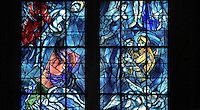 Christ's descent from the cross and the sacrifice of Isaac (left), and Abraham and Melchisedec (right), stained glass window, 1974, by Marc Chagall, 1887-1985, with the studio of Jacques Simon, in the axial chapel of the apse of the Cathedrale Notre-Dame de Reims or Reims Cathedral, Reims, Champagne-Ardenne, France. The cathedral was built 1211-75 in French Gothic style with work continuing into the 14th century, and was listed as a UNESCO World Heritage Site in 1991. Picture by Manuel Cohen