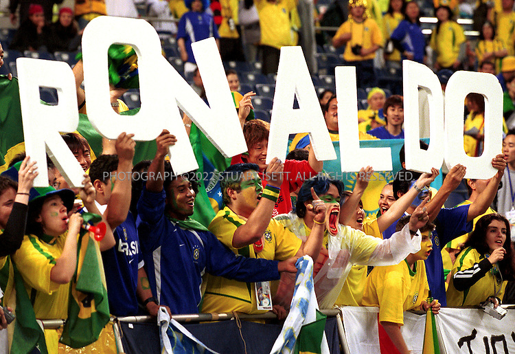 6/27/2002--Saitama, Japan..Brazil fans hold up a 'Ronaldo' sign before Wednesday's semi final match against Turkey. Brazil beat Turkey 1-0, with a second half goal by Ronaldo, and will face Germnay ion the final in Yokohama this Sunday, June 30th....All photographs ©2003 Stuart Isett.All rights reserved.This image may not be reproduced without expressed written permission from Stuart Isett.