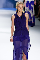 Anabela Belikova walks runway in an indigo eyelet mesh tiered vest with cutout pocket over indigo silk chiffon sheer drawstring maxi skirt.by Vera Wang, for the Vera Wang Spring 2012 collection, during Mercedes-Benz Fashion Week Spring 2012.