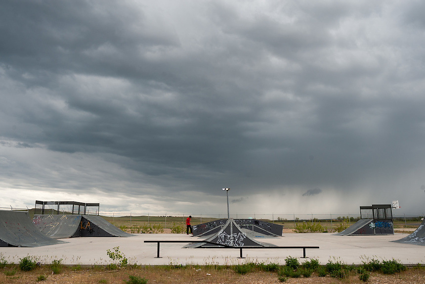 A teenager practices on his skateboard at a lonely skate park on the Crow Reservation at Crow Agency, Montana, Thursday, May 16, 2013. Pending new ports for shipment to Asia through either the U.S. or Canada, Cloud Peak Energey hopes to open new high-grade coal mines on and near the Crow Reservation in southern Montana. The tribe is equally hopeful the new mines would bring long-awaited economic stability to the tribe. (Kevin Moloney for the New York Times)