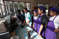 March 23rd, 2011_ BAUCAU, TIMOR-LESTE_ Young women take a cooking course at the Canossa Collage, located in the Timorese town of Baucau.  Canossa is a training centre and dormitory for woman and girls run by the Catholic Church.  Photographer: Daniel J. Groshong/Tayo Photo Group