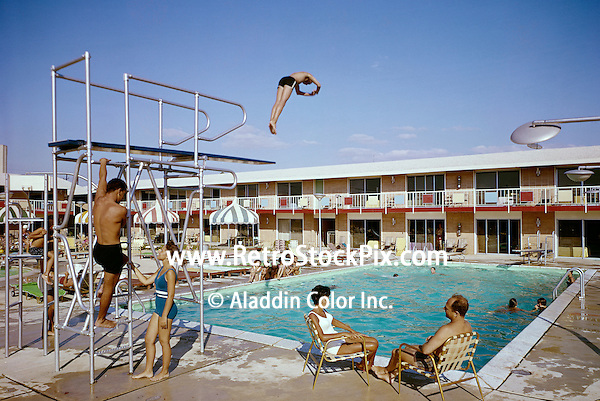The Country Squire Motel pool with high and low diving boards. 1960's