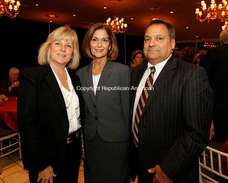 Southington, CT-05 November 2012-110512CM09- SOCIAL MOMENTS---- Left to right, Eileen Regan, President of Sacred Heart High School, Patti Azzara and Anthony Azzara, Principal at Sacred Heart High School, during the 18th annual Sacred Heart High School Awards Dinner and Silent Auction Monday night at the Aqua Turf in Southington. The school was also celebrating it's 90th anniversary.   .  Christopher Massa Republican-American