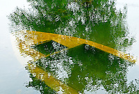 Abstract Water and reflection of a sunken Yellow Boat Ninh Binh, North Vietnam
