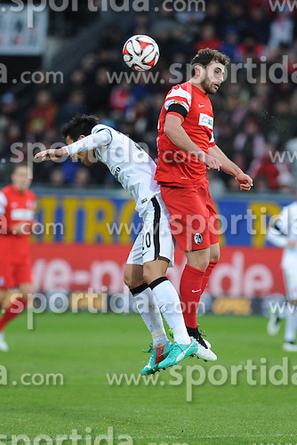 31.01.2015, Schwarzwald Stadion, Freiburg, GER, 1. FBL, SC Freiburg vs Eintracht Frankfurt, 18. Runde, im Bild Kopfballduell, Aktion zwischen (l.) Makoto Hasebe (Eintracht Frankfurt) (r.) Admir Mehmedi (SC Freiburg) // during the German Bundesliga 18th round match between SC Freiburg and Eintracht Frankfurt at the Schwarzwald Stadion in Freiburg, Germany on 2015/01/31. EXPA Pictures &copy; 2015, PhotoCredit: EXPA/ Eibner-Pressefoto/ Laegler<br /> <br /> *****ATTENTION - OUT of GER*****