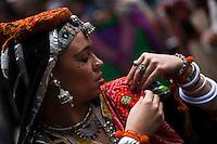 A woman checks her dress while she attends the Holi Hai festival organized by Indian community in New York City March 31, 2013. Photo by Eduardo Munoz Alvarez / VIEWpress.