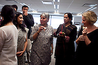 Colleagues share a light moment after the puja (prayer and blessing) ceremony at the opening of the new Bill &amp; Melinda Gates Foundation office in New Delhi, India on 17th December 2010. Photo by Suzanne Lee for Gates Foundation