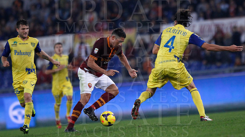 Calcio, Serie A: Roma vs ChievoVerona. Roma, stadio Olimpico, 31 ottobre 2013.<br /> AS Roma forward Marco Borriello, center, is challenged by ChievoVerona defender Dos Santos Claiton, of Brazil, right, as ChievoVerona midfielder Perparim Hetemaj, of Finland, looks on during the Italian Serie A football match between AS Roma and ChievoVerona at Rome's Olympic stadium, 31 October 2013.<br /> UPDATE IMAGES PRESS/Isabella Bonotto