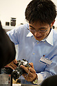 February 9, 2012, Yokohama, Japan - A Olympus staff member shows visitors the Olympus OM-D E-M5 camera at the CP+ Camera and Photo Imaging Show 2012. The event is held from February 9-12. (Photo by Christopher Jue/AFLO)