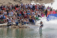 """Cushing Classic at Squaw Valley 6"" - Photograph of a skier crossing a pond during the Cushing Classic at Squaw Valley, USA."