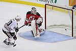 Mar 27; Newark, NJ, USA; Chicago Blackhawks center Patrick Sharp (10) scores a goal on New Jersey Devils goalie Martin Brodeur (30) during the overtime shootout at the Prudential Center. The Devils defeated the Blackhawks 2-1.