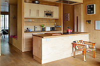 The artist Richard Woods has built a timber house where he can both create and showcase his bold, bright work. The scent of timber pervades the interior with floors of solid oak and walls constructed from cross laminated timber panels. The kitchen units have been clad in a veneer to maintain the uniform wood effect throughout.