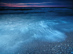 Beautiful dramatic twilight nature scenery of waves on the shore of lake lake Huron, Pinery Provincial Park, Grand Bend, Ontario, Canada.