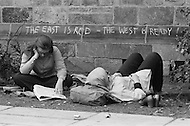 New Haven, CT. May 2nd 1970 Yale University.<br /> Two women relax at Yale University alongside graffiti reading &quot;The East is red - the West is ready!&quot; Students and demonstrators from around the US have gathered on the Yale campus in support of the Black Panther Party while several party leaders, including its cofounder Bobby Seale, are on trial.