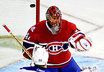 10 April 2010: Montreal Canadiens' goaltender Jaroslav Halak makes a save during the last game of the regular season against the Toronto Maple Leafs at the Bell Centre in Montreal, Quebec, Canada. The Leafs defeated the Habs 4-3 in sudden death overtime as the Canadiens advance to the Stanley Cup Playoffs with the single point. Mandatory Credit: Ed Wolfstein Photo