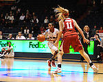 "Ole Miss'  Valencia McFarland (3) scores as Arkansas' Calli Berna (11) at the C.M. ""Tad"" Smith Coliseum in Oxford, Miss. on Thursday, January 12, 2012. Mississippi won 60-54. (AP Photo/Oxford Eagle, Bruce Newman)"