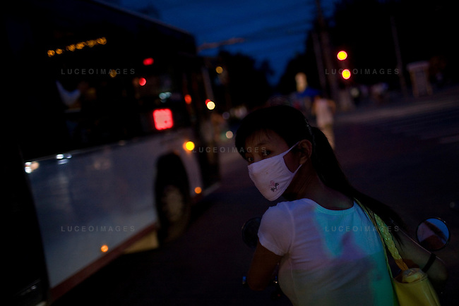 A woman sits in traffic in downtown Beijing, China on Saturday, August 16, 2008.  Kevin German