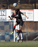 Northeastern University forward Don Anding (12) heads the ball. .NCAA Tournament. University of Connecticut (white) defeated Northeastern University (black), 1-0, at Morrone Stadium at University of Connecticut on November 18, 2012.