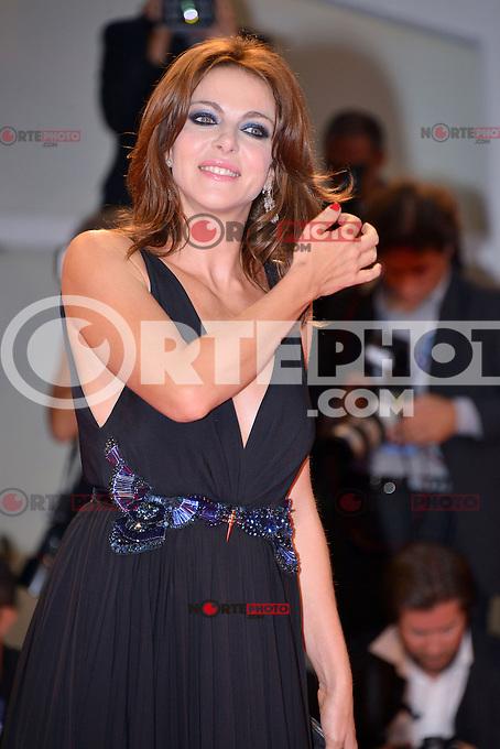 August 30, 2012: Claudia Gerini attends the &quot;Superstar&quot; Screening during the 69th Venice International Film Festival at Palazzo del Casino in Venice, Italy..Credit: &copy; F2F / MediaPunch Inc. /NortePhoto.com<br /> <br /> **CREDITO*OBLIGATORIO** <br /> *No*Venta*A*Terceros*<br /> *No*Sale*So*third*<br /> *** No*Se*Permite*Hacer*Archivo**<br /> *No*Sale*So*third*