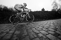 3 Days of West-Flanders, .day 3: Nieuwpoort-Ichtegem.David Boucher pulling so hard his front wheel lifts from the 12% (Kemmelberg) gradient