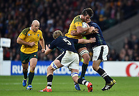 Kane Douglas of Australia takes on the Scotland defence. Rugby World Cup Quarter Final between Australia and Scotland on October 18, 2015 at Twickenham Stadium in London, England. Photo by: Patrick Khachfe / Onside Images