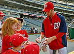 16 May 2012: Washington Nationals outfielder Bryce Harper signs autographs prior to a game against the Pittsburgh Pirates at Nationals Park in Washington, DC. The Nationals defeated the Pirates 7-4 in the first game of their 2-game series. Mandatory Credit: Ed Wolfstein Photo