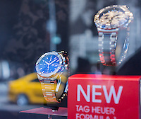 Luxury watches in the window of the TAG Heuer watch store on Fifth Avenue in New York on Thursday, March 19, 2015. The Swiss watchmaker announced it has partnered with Google and Intel to create a luxury smartwatch in competition with the Apple Watch and any other smartwatches on the consumer electronics horizon. The device is scheduled for an end of 2015 launch.  (© Richard B. Levine)