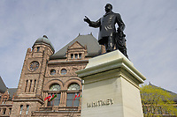 Toronto (ON) CANADA - April 24 2008 File Photo<br /> Statue of Whitney in front of the Legislative Assembly of Ontario in<br />  Queens Park ( in the Downtown area of Toronto)<br /> <br /> <br />  Opened in 1860 by Edward, Prince of Wales, it was named in honour of Queen Victoria. The park is the site of the Ontario Legislature, which houses the Legislative Assembly of Ontario, and so the phrase Queen's Park is also frequently used to refer to the Government of Ontario.