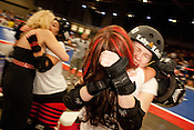 Lady Libertine and members of Putas del Fuego congratulate each other after defeating the Hellcats at Palmer Events Center in Austin, Texas.
