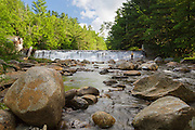 Parker's Dam along the Pemigewasset River in Woodstock, New Hampshire USA during the summer months. This is the site of an old mill dating back to the logging era