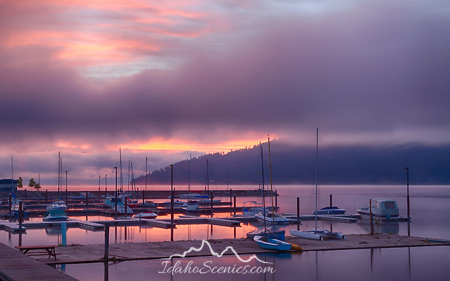 Idaho, North, Bonner County, Sandpoint. Boats at dock in the marina on a calm morning under  colorful pre- sunrise light.