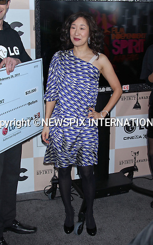 "SANDRA OH.INDEPENDENT SPIRIT AWARDS.Santa Monica, California_26/2/2011.Mandatory Photo Credit: ©M.Philips_Newspix International..**ALL FEES PAYABLE TO: ""NEWSPIX INTERNATIONAL""**..PHOTO CREDIT MANDATORY!!: NEWSPIX INTERNATIONAL(Failure to credit will incur a surcharge of 100% of reproduction fees)..IMMEDIATE CONFIRMATION OF USAGE REQUIRED:.Newspix International, 31 Chinnery Hill, Bishop's Stortford, ENGLAND CM23 3PS.Tel:+441279 324672  ; Fax: +441279656877.Mobile:  0777568 1153.e-mail: info@newspixinternational.co.uk"