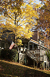 House with wooden deck during fall autumn yellow red leaves colors colorful