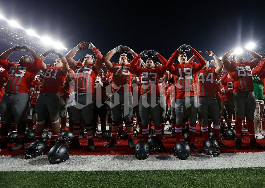 Ohio State Buckeyes players sing Carmen Ohio following NCAA football game against the Nebraska Cornhuskers at Ohio Stadium in Columbus on Nov. 5, 2016. Ohio State won 62-3. (Adam Cairns / The Columbus Dispatch)