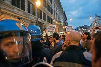 Roma 13 Ottobre 2011.Indignati presidiano e si accampano in via Nazionale nei pressi di palazzo Koch sede di Bankitalia.secondo giorno sulla scalinata del Palazzo delle Esposizioni. Le forze dell'ordine respingono il corteo con il drago