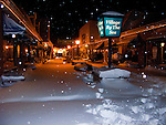 """Snow and ice coat windows and sign of businesses along Rehoboth Avenue, the """"main street"""" of Rehoboth Beach, Delaware, USA, during the blizzard of February 2010."""