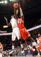 Feb. 2, 2011; Charlottesville, VA, USA; Virginia Cavaliers center Assane Sene (5) fights for the rebound with Clemson Tigers forward/center Jerai Grant (45) during the game at the John Paul Jones Arena. Virginia won 49-47. Mandatory Credit: Andrew Shurtleff