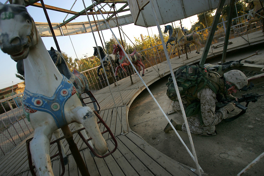 After a careful search, Marines with 1st Platoon Golf Company 2nd Battalion 5th Marines uncover a stash of weapons hidden by insurgents in an abandoned amusement park in central Ramadi on January 7, 2005.