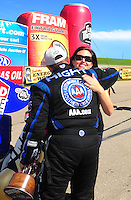 May 22, 2011; Topeka, KS, USA: NHRA funny car driver Robert Hight celebrates with Ashley Force Hood after winning the Summer Nationals at Heartland Park Topeka. The victory marked the 200th victory for John Force Racing. Mandatory Credit: Mark J. Rebilas-