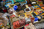Colorful herbs and spices on display in marketplace in Ecuador