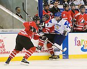 Brayden McNabb (Canada - 3), Joey Hishon (Canada - 18), Iiro Pakarinen (Finland - 10)  - Finland defeated Canada 5-4 (so) in the 2009 World Under 18 Championship bronze medal game at the Urban Plains Center in Fargo, North Dakota, on Sunday, April 19, 2009.