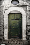 A green door Penne, a comune in the province of Pescara, in the Abruzzo Region of central Italy. It sits in the hills between the Apennine Mountains and the Adriatic Sea.