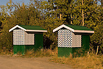 Two green road-side outhouses east of the Continental Divide (Arctic Ocean side) along the Alcan Highway in The Yukon