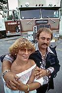 Kansas City, Missouri, September 9, 1978. Mr. Sonny and Mrs. Jean Gross from La Mesa, California posing in front of their Freightliner truck.