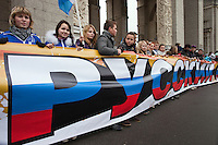 Moscow, Russia, 04/11/2011..On Russian National Unity Day members of the pro-Kremlin youth group &quot;Nashi&quot; hold their own Russian March to counter the racist and xenophobic sentiments of the nationalist Russian March held on the same day for the last several years. Demonstrators wore masks of images of various Russian ethnic groups in a call for national unity and ethnic harmony.